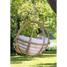 round white wicker hanging swing chair with green cushions and