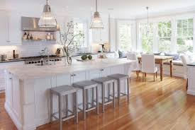 kitchens alternative decor featuring white wooden cabinetry unit kitchens alternative decor with white wooden cabinetry unit and white subway back splash and black iron stove along with chrome range hood also rectangle