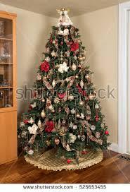 christmas tree presents lights reflecting windows stock photo