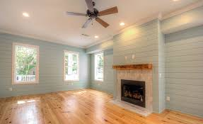 living room with pine flooring not shiplap nickel gap