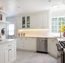 white raised panel kitchen cabinets vintage white maplevilles cabinetry