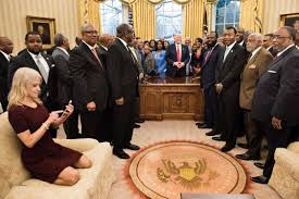 kellyanne conway kneels on oval office couch sparks debate q13