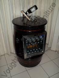 wine barrel bar table with a glass door bar fridge built into it