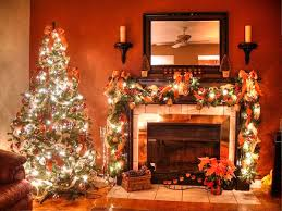 decorations bright christmas tree in front of fireplace