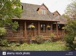 log home styles rustic canadian cottage style log home facade and landscaped front