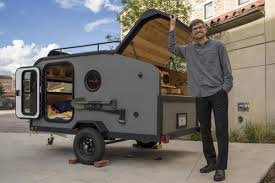 program in environmental design university of colorado boulder student poses with camper which he designed for the design studies capstone in may 2017
