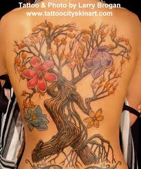 city skin studio tattoos flower bootywood tree