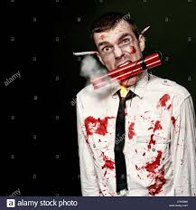 halloween blood background zombie bomber holding a mouthful of dynamite while