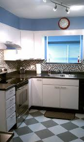 how to clean white melamine kitchen cabinets susan transforms 1980s kitchen for 600