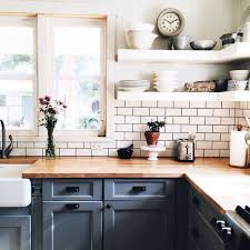 kitchen subway backsplash open shelves lower cabinets painted blue butcher block counters