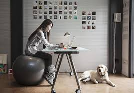 Sitting On A Medicine Ball At Desk How To Exercise And Stay Fit At Work