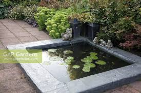 gap gardens small square pond with frog ornaments image no