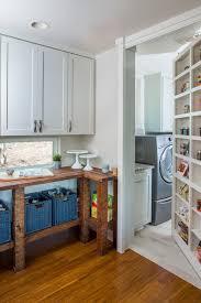 hidden door bookcase closet laundry room transitional with