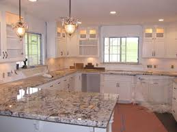 granite countertop white kitchen cabinets backsplash