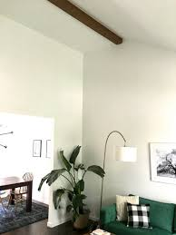 vaulted ceiling living room our faux wood beam in our vaulted living room ceiling create