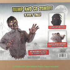 motion activated halloween decorations funny animated bump and go zombie torso haunted house halloween