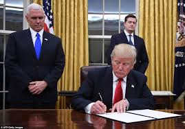 president trump signs first orders in oval office daily mail online