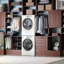 25 space saving multipurpose laundry rooms view in gallery contemporary master closet along with the laundry is a match made in heaven from
