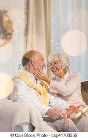 what to get an elderly woman for christmas senior holding christmas gift happy elderly woman and