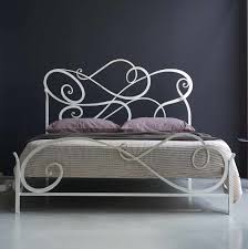 bedroom far flung black iron bed frame and bars plus curving top