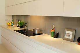 the strong linear lines in this handleless krantz designed kitchen