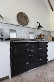 great kitchen bleached wood floor black stove white smooth