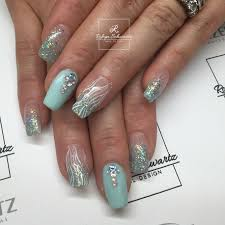 teal glitters and gel polish on natural nails blingy nails