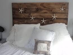 high diy headboard made from reclaimed wood with beach theme