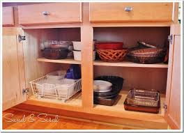 Kitchen Cabinet Organizer Kitchen Cabinet Organization Taming The Tupperware Sand And Sisal