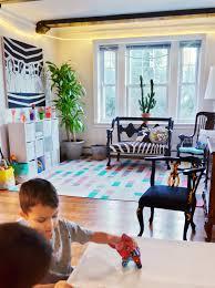 land of nod playroom design rug pillow toy bins
