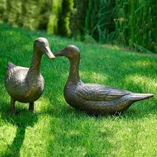 pair of ducks with aged bronze finish metal garden ornaments