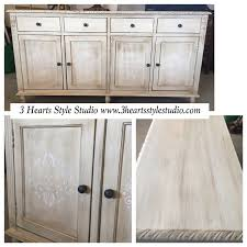 refinished antique white buffet with ornate stenciling in panels