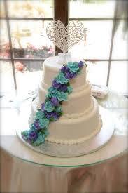 simple elegant wedding cake blue and purple flowers butter