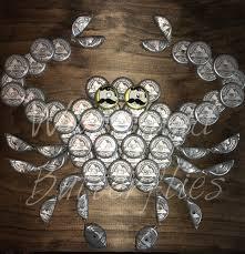 the original coors light silver bottle cap crab