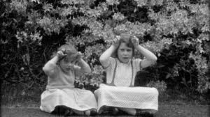 young queen elizabeth ii sings and plays with her sister