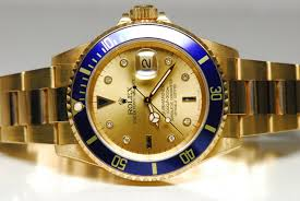 golden rolex rolex submariner 18ct yellow gold date with gold dial u0026 blue bezel
