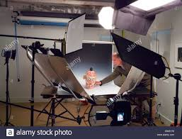 commercial photographer photographer working in a commercial photography studio with