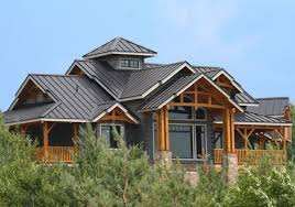dark blue wood siding house with a metal roof amazing exterior