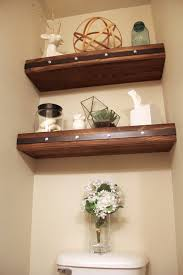 Wood Bathroom Shelves by Diy Floating Shelves With Faux Rivets