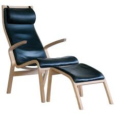 Beech Ottoman Armchair And Ottoman Model Zurich In Beech And Black Leather By