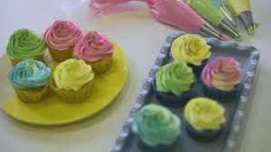 process of making delicious cupcakes in a bakery shop stock