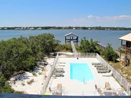 5 5 beach home on the lagoon with backyard pool u0026 boat dock gulf