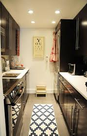 kitchen cabinets galley style galley style kitchen love the graphic rug i need a small stepper