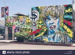 a colorful wall mural on melrose ave in los angeles california a colorful wall mural on melrose ave in los angeles california depicts a stylized