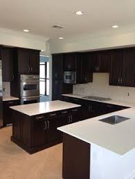 black cabinets white countertops kitchen with dark cabinets and white quartz counters and marble