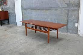 extending a teak coffee table