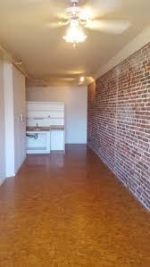 400 sqft studio with exposed brick interior and views concourse