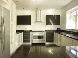 granite countertop black brown kitchen cabinets handmade tiles