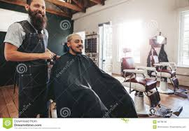 hipster man getting haircut at barber shop stock photo image