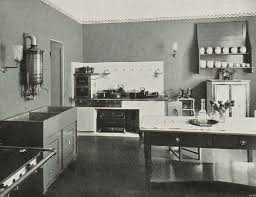 wow 1906 kitchen interior with two stoves and a super modern